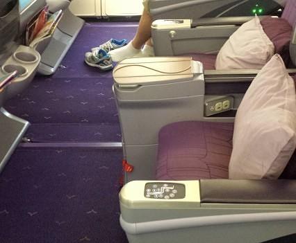 Shoeless passenger enjoys the legroom.