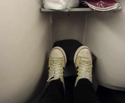 Feet jammed in footwell.
