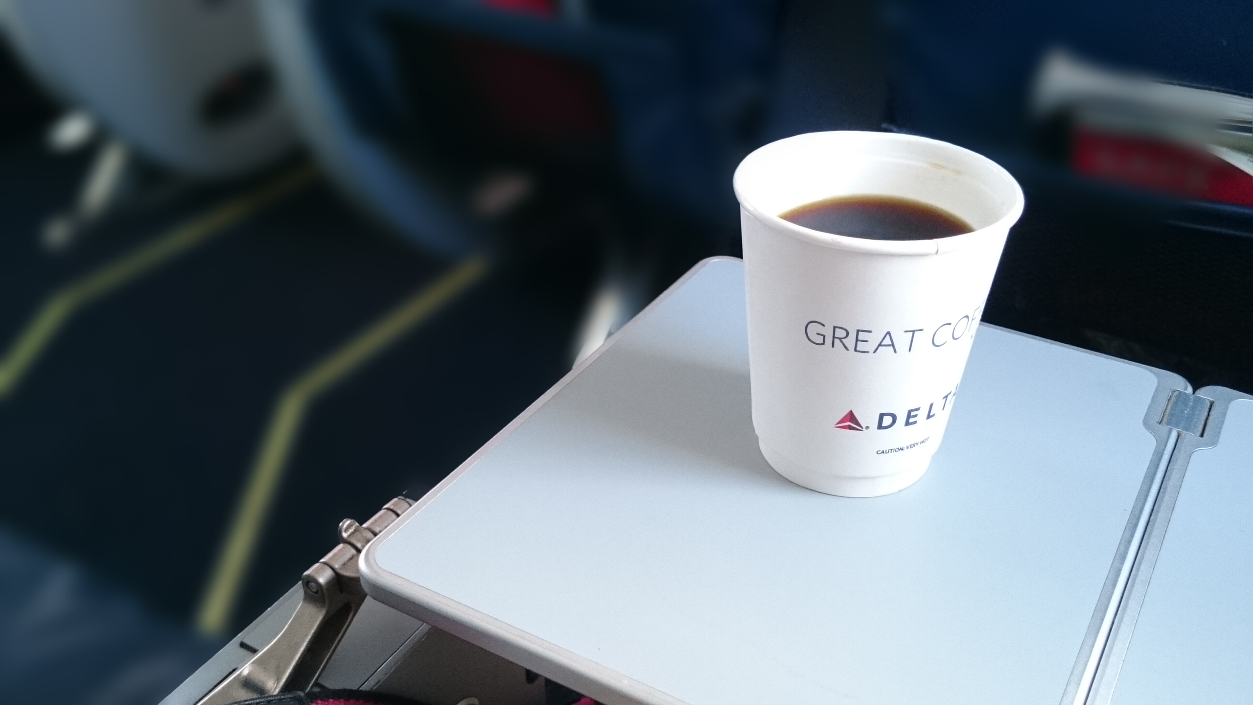 Delta Comfort Plus in row 5 with tray extended...and coffee.