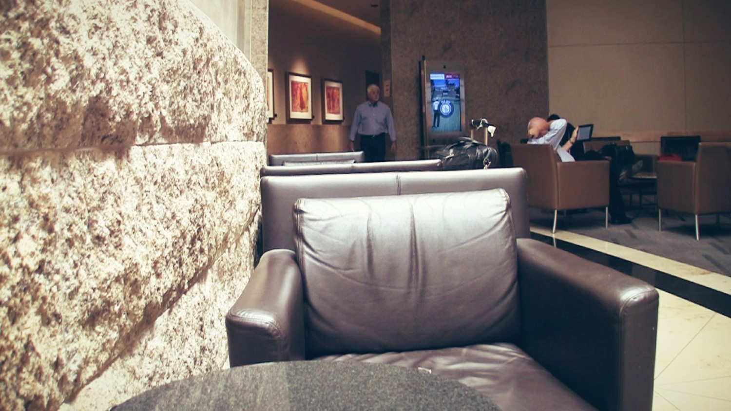 Seating in the main hallway of American Airlines Admirals Club DFW TA