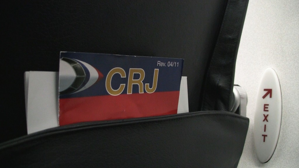 American Airline flights aboard the CRJ-700 are typically flown by American Eagle. - Safety Card