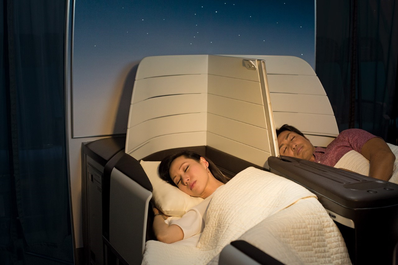 Snoozing in your Hawaiian Airlines Business Class Seat
