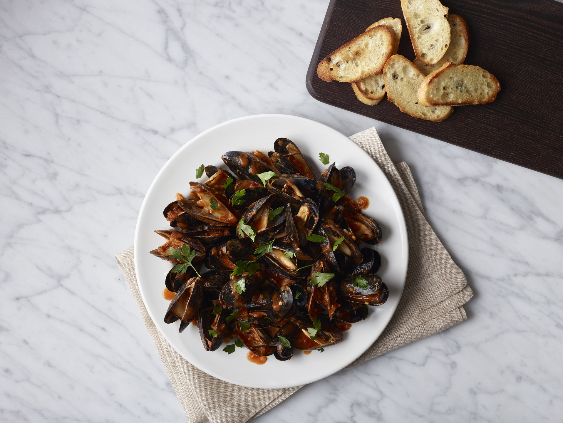 Mussels are on the menu inside the Polaris by United Business Class Lounge.