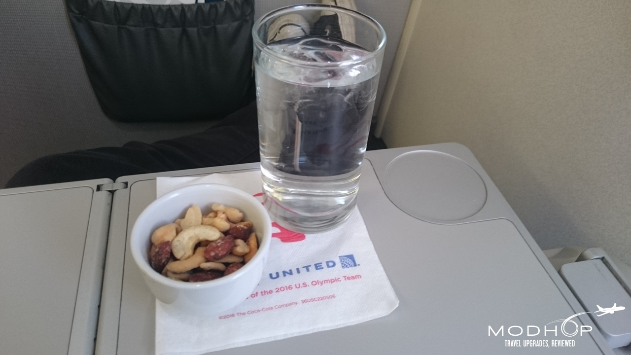 United Embraer 175 snack and drink service in first.
