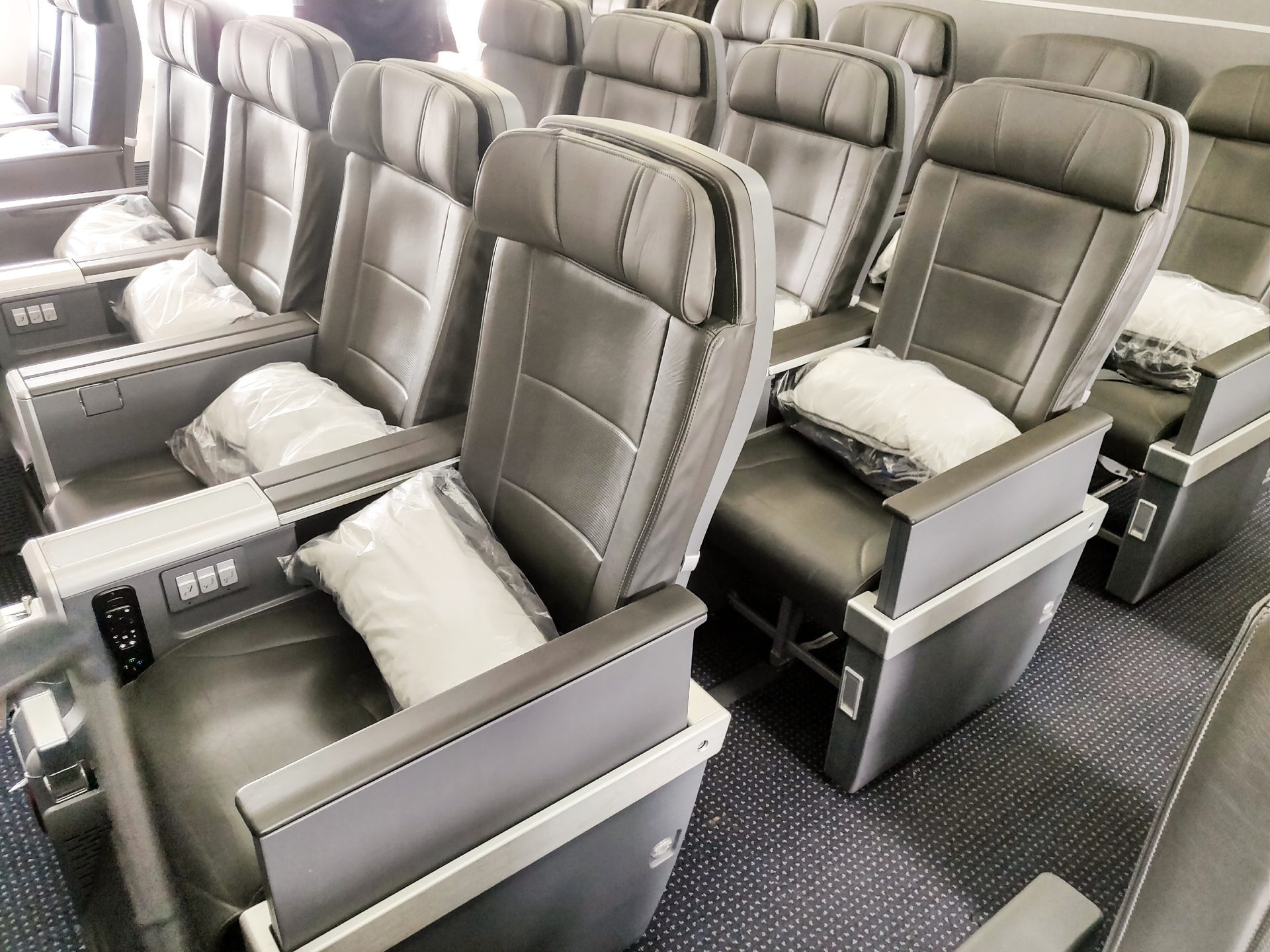 Travel Like a Mid-Level BOSS in American Airlines Premium Economy.