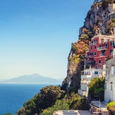 Scenic view of colorful houses on Capri island with Vesuvio background