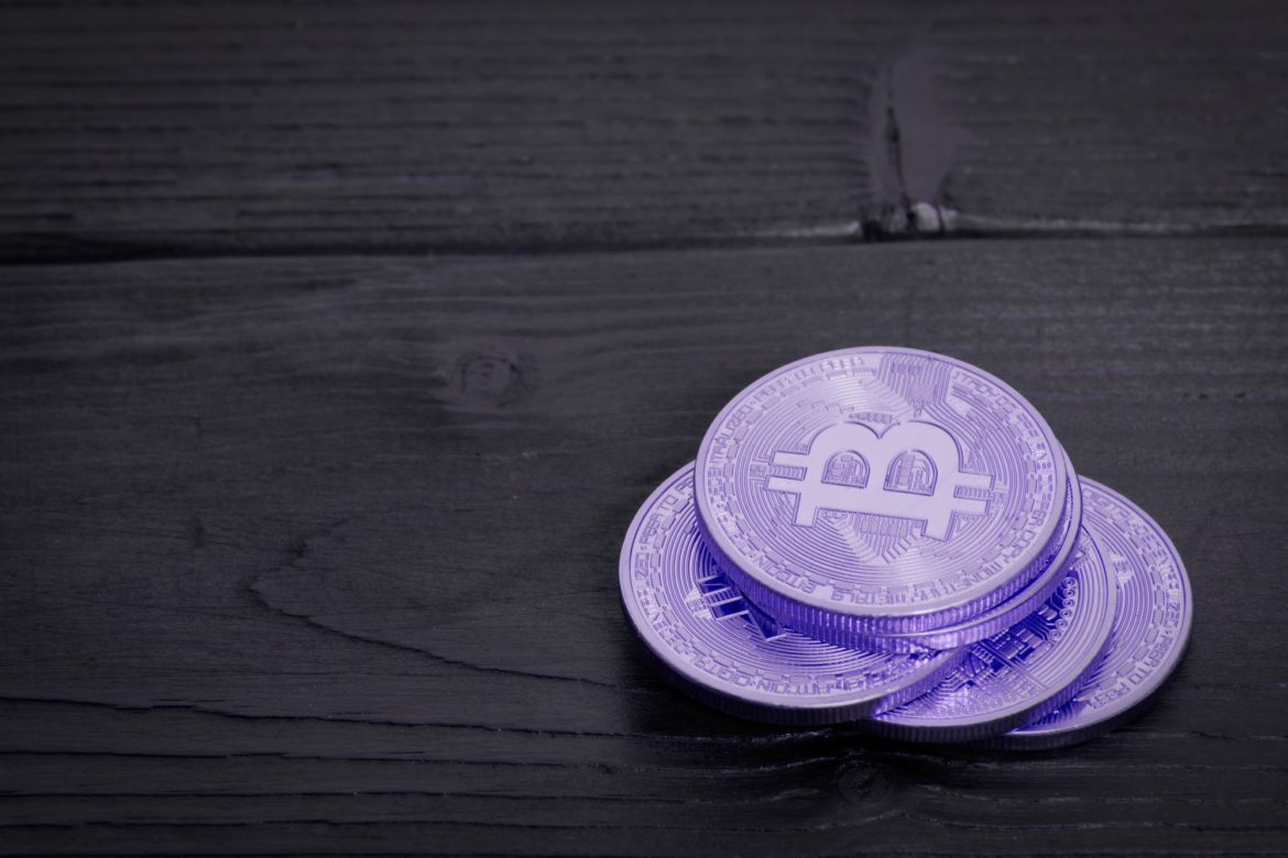 Violet Bitcoins on a table