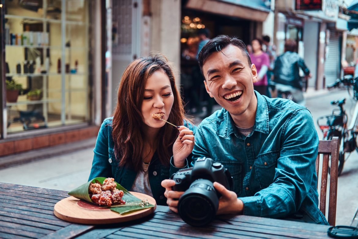 Asian couple enjoy chinese food and watching pictures