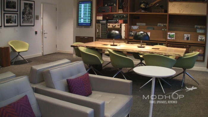 """Loungers and Communal table inside this American Express Lounge """"The Centurion"""" at New York LaGuardia"""